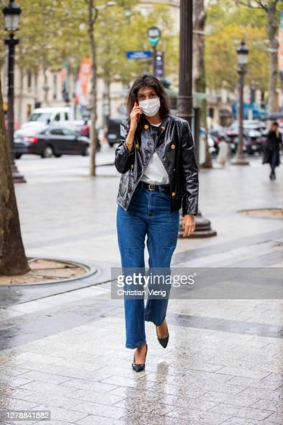 Emmanuelle Alt seen wearing denim jeans, black jacket outside Miu Miu lunch during Paris Fashion Week - Womenswear Spring Summer 2021 : Day Nine on...