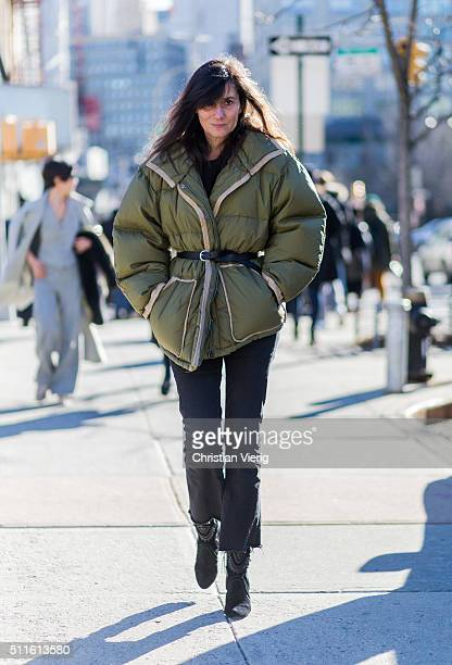 Emmanuelle Alt wearing a shearling denim jacket and denim jeans and brown gloves seen outside Calvin Klein during New York Fashion Week Women's...