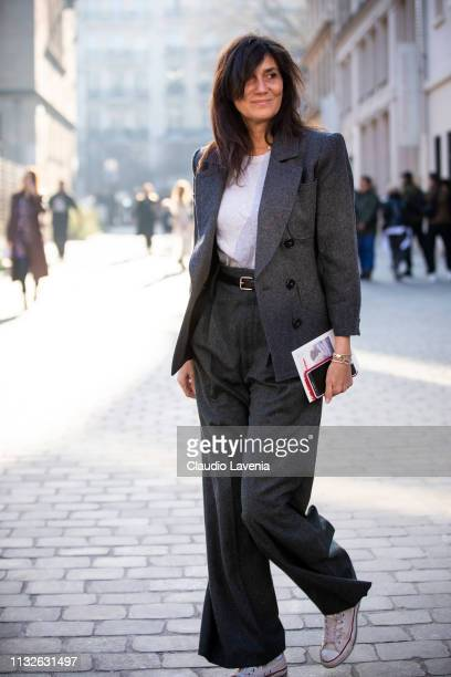 Emmanuelle Alt wearing a white tshirt dark Rey suit and white Converse is seen outside Lanvin on Day 3 Paris Fashion Week Autumn/Winter 2019/20 on...