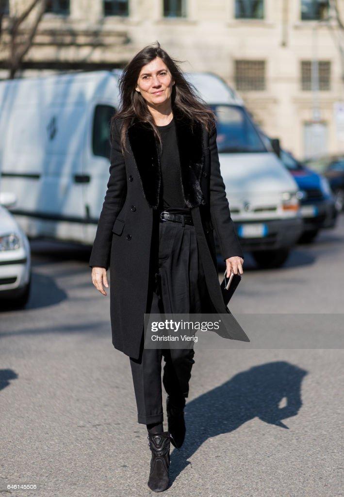 Emmanuelle Alt wearing black coat outside Armani during Milan Fashion Week Fall/Winter 2017/18 on February 27, 2017 in Milan, Italy.