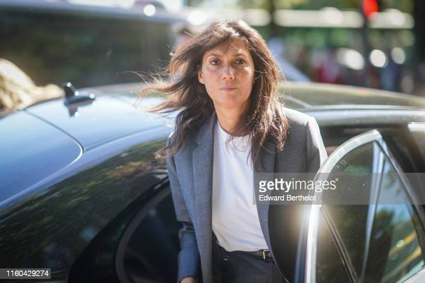 Emmanuelle Alt wears a blazer jacket a white top outside Alexandre Vauthier during Paris Fashion Week Haute Couture Fall/Winter 2019/2020 on July 02...