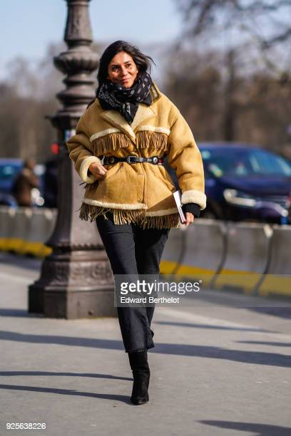 Emmanuelle Alt wears a coat with fringes during Paris Fashion Week Womenswear Fall/Winter 2018/2019 on February 28 2018 in Paris France