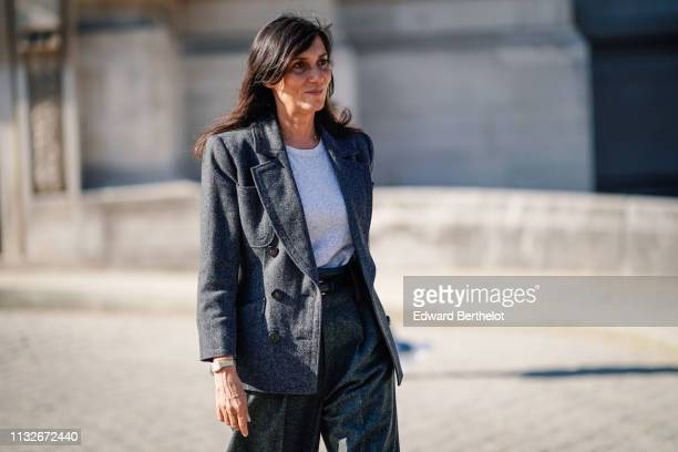 Emmanuelle Alt wears a gray blazer jacket flare pants outside Maison Margiela during Paris Fashion Week Womenswear Fall/Winter 2019/2020 on February...