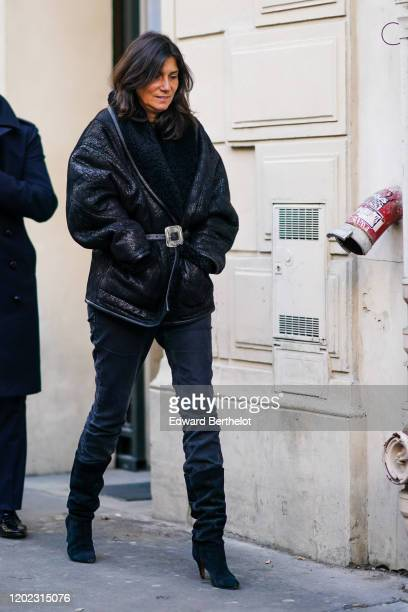 Emmanuelle Alt wears a leather aviator jacket with wool black inner lining black pants pointy boots outside Maison Margiela during Paris Fashion Week...