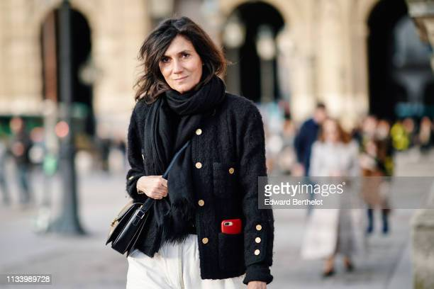 Emmanuelle Alt wears a military jacket with buttons white pants outside Louis Vuitton during Paris Fashion Week Womenswear Fall/Winter 2019/2020 on...