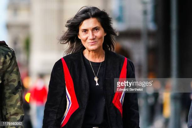 Emmanuelle Alt wears necklaces a black top a black jacket with red white and blue inserts outside Louis Vuitton during Paris Fashion Week Womenswear...