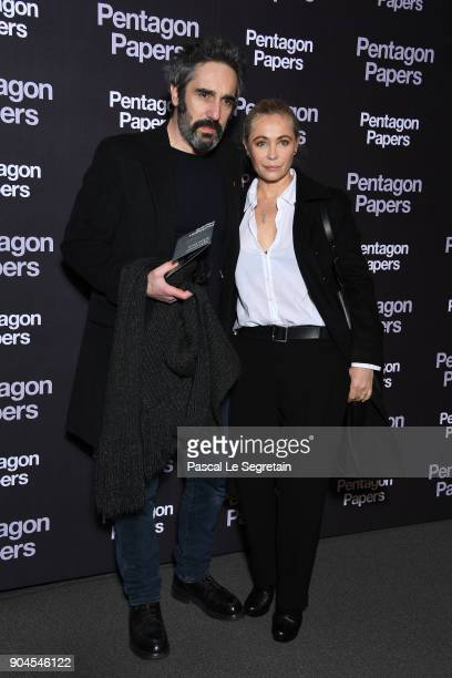 Emmanuelle Beart and her partner attend Pentagon Papers Premiere at Cinema UGC Normandie on January 13 2018 in Paris France