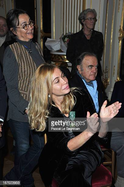 Emmanuelle Beart poses with her mother Genevieve Galea and father Guy Beart at Ministere de la Culture on November 27 2012 in Paris France