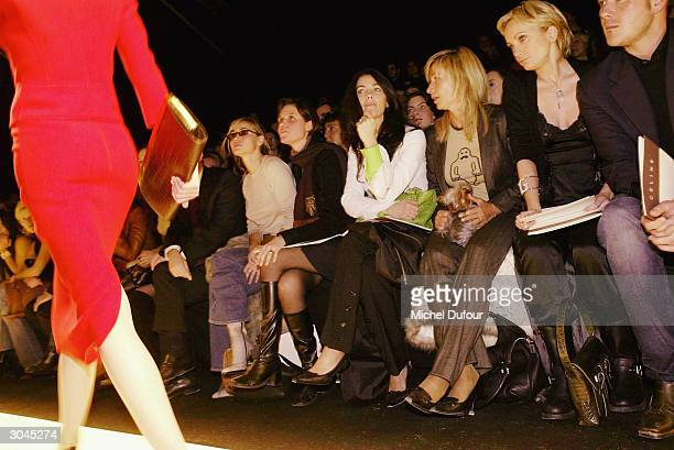 Emmanuelle Beart with a friend Christina Reali Natty Belmondo and Patricia Kaas with her friend all attend the Celine ReadyToWear FallWinter 20042005...