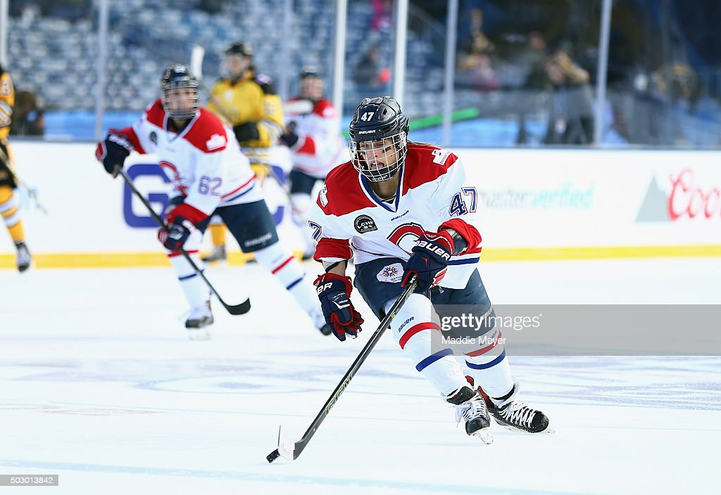 Emmanuelle Blais #47 of the Les Canadiennes (CWHL) carries the puck against the Boston pride (NWHL) during the Outdoor Womens Classic at Gillette Stadium on December 31, 2015 in Foxboro, Massachusetts.