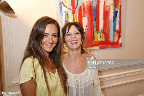 Emmanuelle Boidron and Zoe Tellier attend the 'Love EtcÉ' Caroline Faindt Exhibition Preview at '28 Octobre Office' on October 17 2017 in Paris France