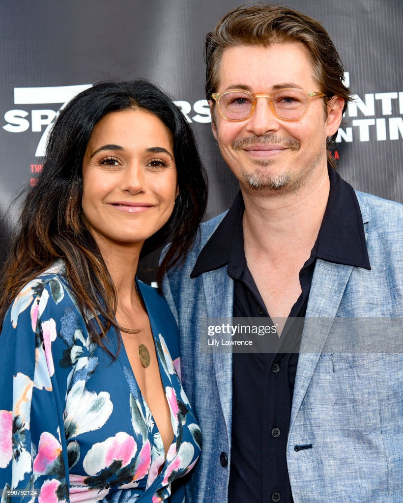 Emmanuelle Chriqui and Edoardo Ballerini arrive at the '7 Splinters In Time' Premiere at Laemmle Music Hall on July 11, 2018 in Beverly Hills, California.