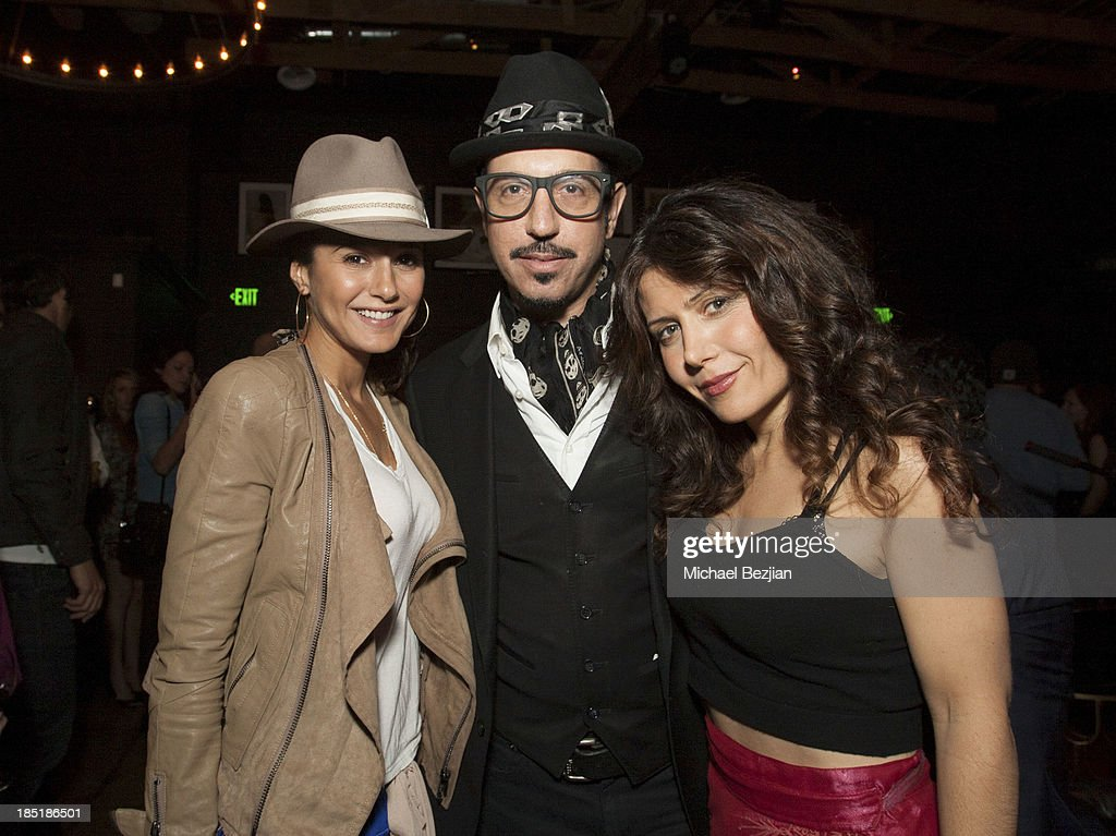 Emmanuelle Chriqui, Dino Magis and Lili Haydn attend Songs Of Hope Event Benefiting The Somaly Mam Foundation on October 17, 2013 in Hollywood, California.