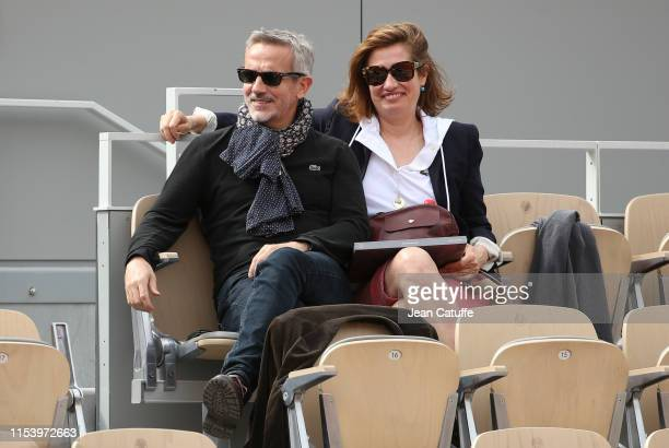 Emmanuelle Devos and her companion Jean-Pierre Lorit attend day 5 of the 2019 French Open at Roland Garros stadium on May 30, 2019 in Paris, France.