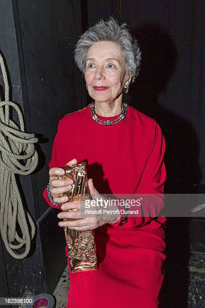 Emmanuelle Riva sits backstage and holds the best actress Cesar award she received for 'Amour' during the Cesar Film Awards 2013 at Theatre du...