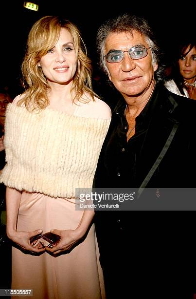 Emmanuelle Seigner and Roberto Cavalli during Milan Fashion Week Autumn/Winter 2006 Roberto Cavalli Front Row at Arco della Pace Piazza Semipione in...
