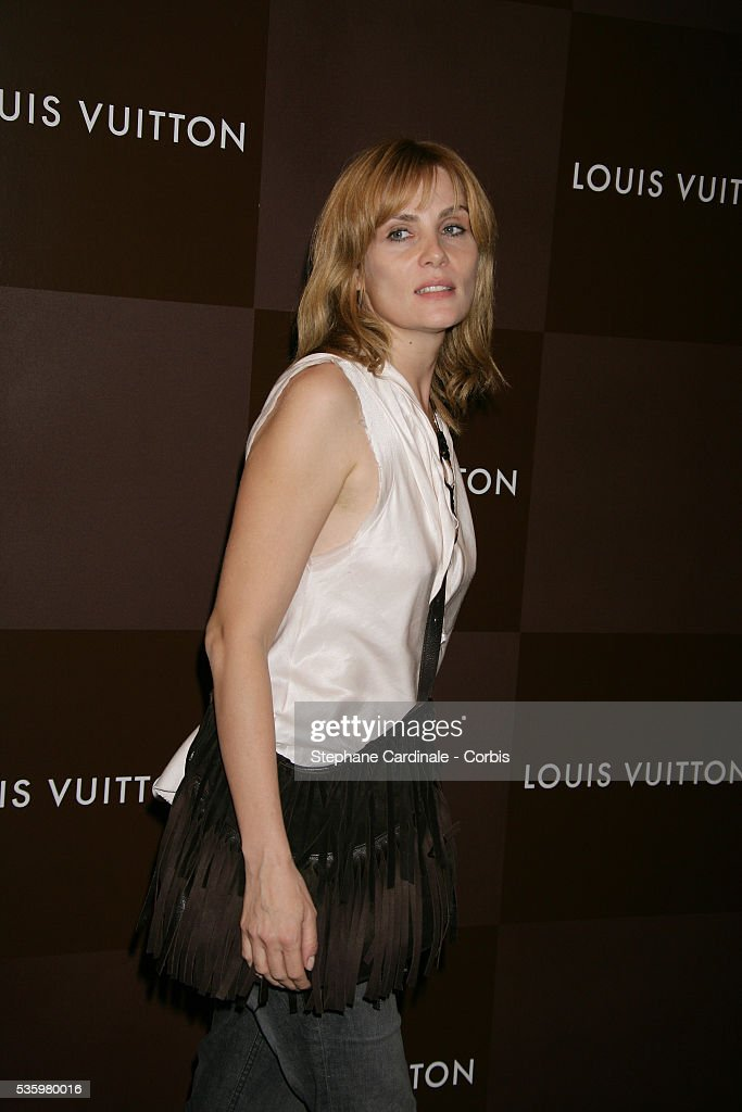 Emmanuelle Seigner arrives at the opening of the new and biggest Louis Vuitton shop in the world on the Champs Elysees, Paris.