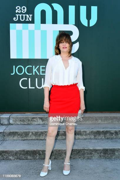 Emmanuelle Seigner attends Miu Miu Club event at Hippodrome d'Auteuil on June 29 2019 in Paris France