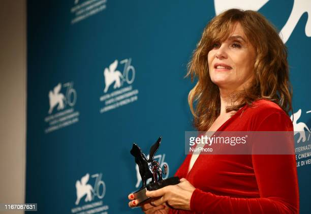 Emmanuelle Seigner attends the awards ceremony winners photocall of the 76th Venice Film Festival on September 7 2019 at Venice Lido