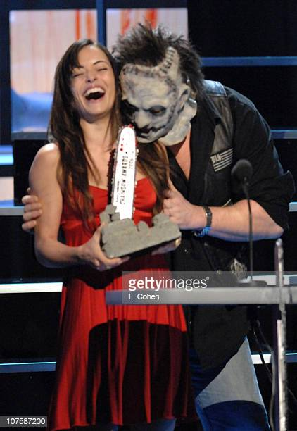Emmanuelle Vaugier accepts the Most Thrilling Killing award for 'Saw II' from Leatherface