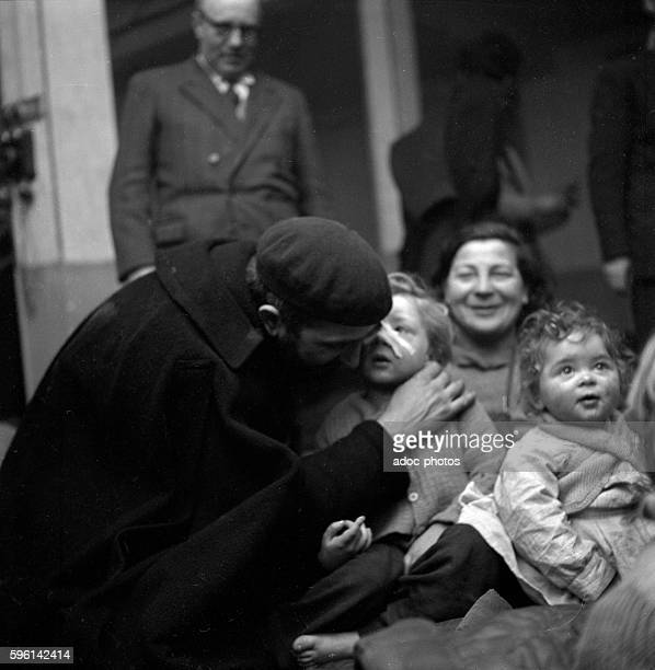 Emmaus movement Abbé Pierre comforting a family In January 1954