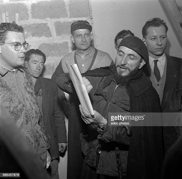 Emmaus movement Abbe Pierre during the social housing construction of the Cité de la Joie in PlessisTrévise In February 1954