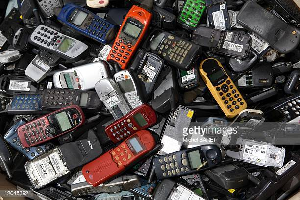 Emmaus stock in bulk of mobile phones in Chollet, France on December 05, 2007 - Pictured bulk stock of mobile phones of different brands, different...