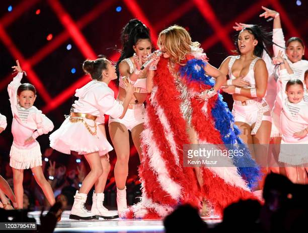 Emme Maribel Muñiz and Jennifer Lopez perform onstage during the Pepsi Super Bowl LIV Halftime Show at Hard Rock Stadium on February 02 2020 in Miami...