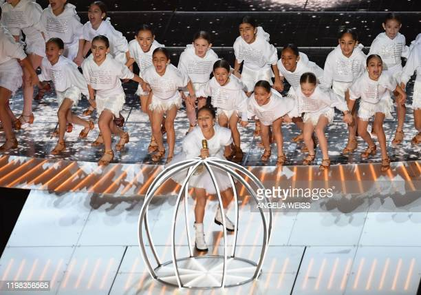 Emme Muniz daughter of US singer Jennifer Lopez performs during the halftime show of Super Bowl LIV between the Kansas City Chiefs and the San...