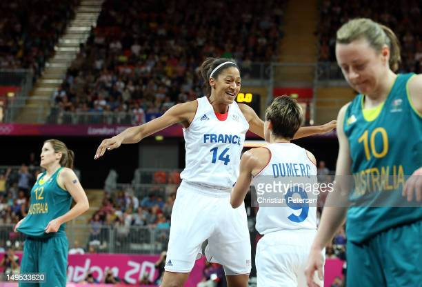 Emmeline Ndongue and Celine Dumerc of France celebrate after defeating Australia in overtime of the Women's Basketball Preliminary Round match on Day...