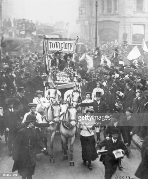Emmeline Pankhurst and Christabel Pankhurst after a breakfast party at the Inns of Court Hotel 22nd December 1908 The street is packed with people...