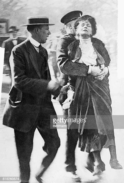 Emmeline Pankhurst is led away by a policeman after leading a group of suffragettes in an attempt to present a petition to the King at Buckingham...