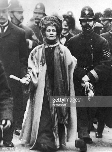 Emmeline Pankhurst surrounded by police officers circa 1900s