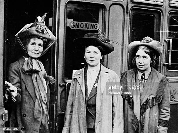 Emmeline with her daughters Christabel and Sylvia Pankhurst Waterloo Station London 4th October 1911 Emmeline was setting off for a lecture tour of...