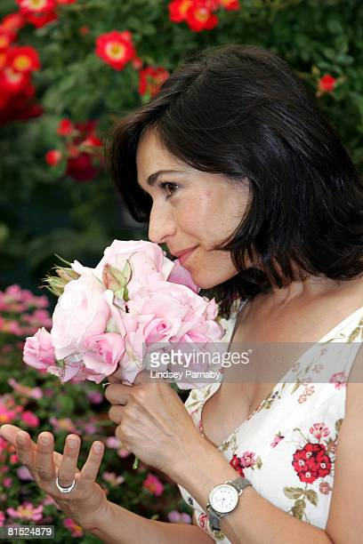 Emmerdale actress Georgia Slowe smells the scent of the Millie Rose at Royal Horticultural Society and BBC Garderners' World live show at the...