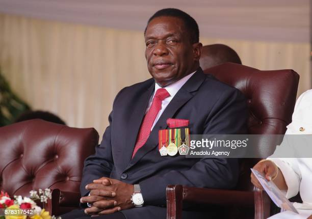 Emmerson Mnangagwa gestures at the National Sports Stadium during his oathtaking ceremony following Robert Mugabes resignation in Harare Zimbabwe on...