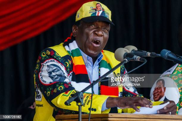 Emmerson Mnangagwa, Zimbabwe's President and presidential candidate for the ZANU PF party, speaks during his last campaign rally at the National...