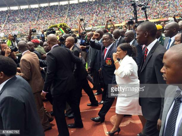 Emmerson Mnangagwa Zimbabwe's president elect center and his wife Auxilia Mnangagwa acknowledge the crowd as they arrive for his presidential...
