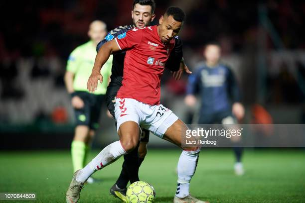 Emmerson of Vejle Boldklub and Besar Halimi of Brondby IF compete for the ball during the Danish Superliga match between Vejle BK and Brondby BK at...