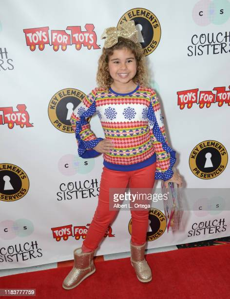 Emmersyn Fiorentino attends The Couch Sisters 1st Annual Toys For Tots Toy Drive held onNovember 20 2019 in Glendale California