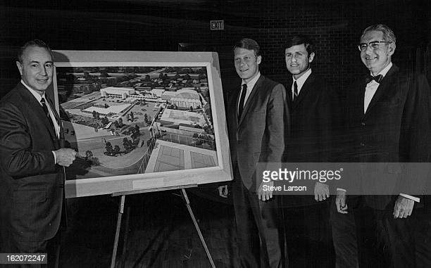 Emmet Heitler, left, samsonite corp. Executive, Reviews Arcgitect's plans on Additions; Listening are Richard Shwayder, next to Heitler, and Gary...