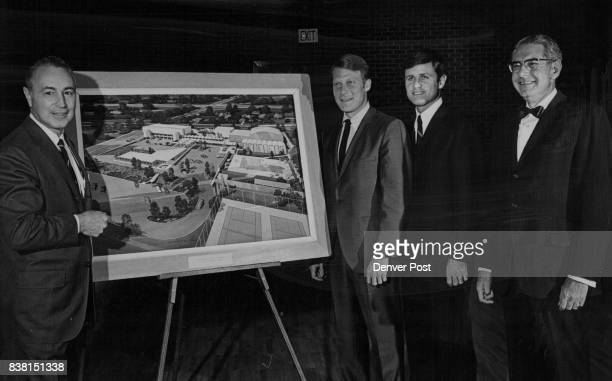 Emmet Heitler, left, samsonite corp. Executive, Reviews Arcgitect's plans on Additions Listening are Richard Shwayder, next to Heitler, and Gary...