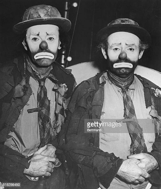Emmett Kelly , noted for his role of the sad clown in the Ringling Brothers & Barnum Bailey Circus, is matched for costume and makeup by actor Henry...