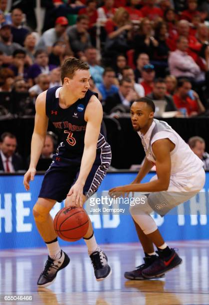 Emmett Naar of St Mary's dribbles the ball around Parker JacksonCartwright of Arizona during the 2017 NCAA Men's Basketball Tournament held at Vivint...