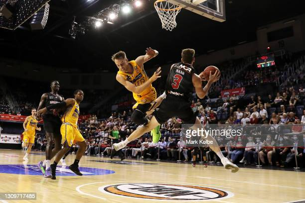 Emmett Naar of the Hawks is fouled by Nathan Sobey of the Bullets as he drives the ball to the basket during the round 11 NBL match between the...