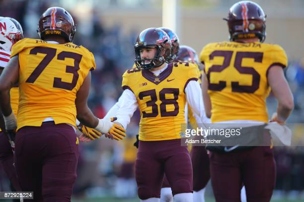 Emmit Carpenter of the Minnesota Golden Gophers celebrates an extra point in the fourth quarter against the Minnesota Golden Gophers at TCF Bank...