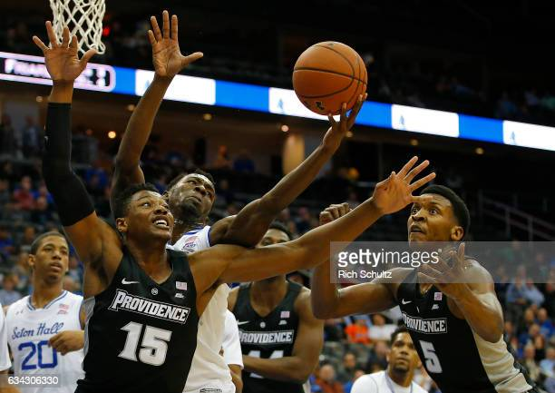 Emmitt Holt and Rodney Bullock of the Providence Friars battles Madison Jones of the Seton Hall Pirates for a rebound during the first half of an...