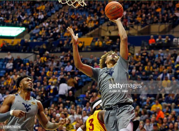 Emmitt Matthews Jr #11 of the West Virginia Mountaineers lays one in against the Iowa State Cyclones at the WVU Coliseum on February 5 2020 in...