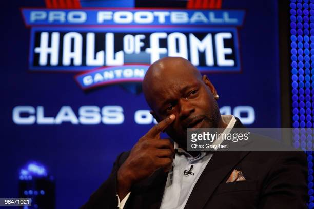 Emmitt Smith is overcome with emotion on stage after he was announced as one of the newest enhrinees into the Hall of Fame during the Pro Football...