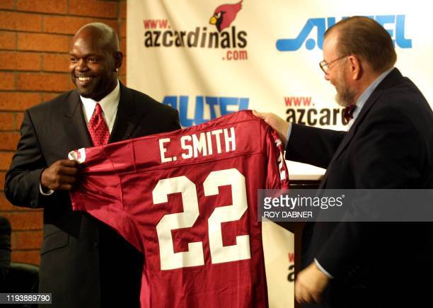 Emmitt Smith is presented his new game jersey by Arizona Cardinals owner Bill Bidwell as Smith the alltime leading NFL rusher is introduced to the...